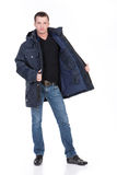 Winter Fashion. Young man in down jacket stock image