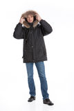 Winter Fashion. Young man in down jacket stock images