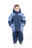 Winter Fashion. Little boy in winter down clothes royalty free stock photo