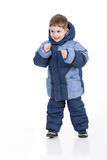 Winter Fashion. Little boy in winter down clothes stock photo