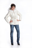 Winter Fashion. Young woman in down coat royalty free stock photography