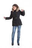 Winter Fashion. Young woman in down coat royalty free stock photos