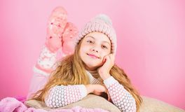 Winter fashion accessory. Kid girl knitted hat and scarf. Winter accessory concept. Girl long hair dream pink background. Kid dreamy wear knitted hat. Winter stock photos