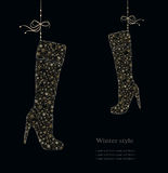 Winter fashion boots from snowflakes. Royalty Free Stock Image