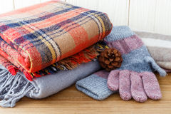 Winter fashion clothing. With scarf gloves and blanket Royalty Free Stock Images