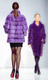 Winter fashion elegant Two Woman clothes in mink fur purple coat Stock Photo