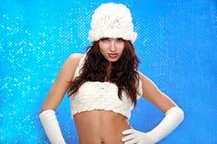 Winter fashion Girl, blue bokeh background Royalty Free Stock Photography