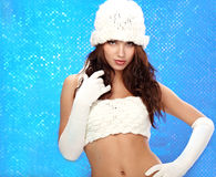 Winter fashion Girl, blue bokeh background Royalty Free Stock Photography