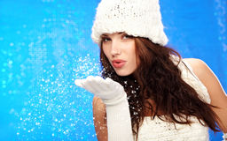 Winter fashion Girl, blue bokeh background Royalty Free Stock Photos