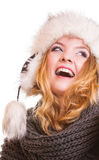 Winter fashion girl in fur hat doing fun isolated Stock Images