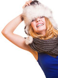 Winter fashion girl in fur hat doing fun isolated Royalty Free Stock Photography