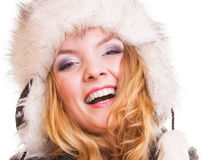 Winter fashion girl in fur hat doing fun isolated Royalty Free Stock Photos