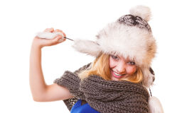 Winter fashion girl in fur hat doing fun isolated Stock Photos