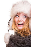 Winter fashion girl in fur hat doing fun isolated Royalty Free Stock Image