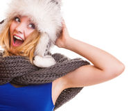Winter fashion girl in fur hat doing fun isolated Stock Photo