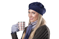Winter fashion girl holding a hot cup of tea Stock Photo