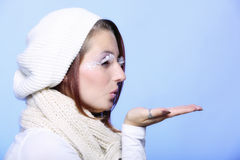 Winter fashion girl warm clothing creative makeup blowing kiss Royalty Free Stock Photos