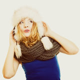 Winter fashion. Happy young woman in fur hat. Stock Photography