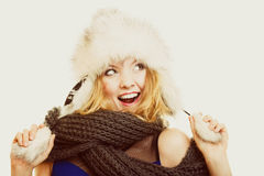 Winter fashion. Happy young woman in fur hat. Stock Photos