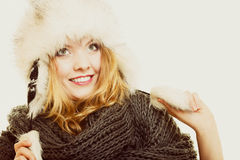 Winter fashion. Happy young woman in fur hat. Royalty Free Stock Photos