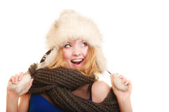 Winter fashion. Happy young woman in fur hat. Royalty Free Stock Photo