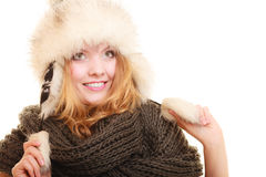 Winter fashion. Happy young woman in fur hat. Stock Photo