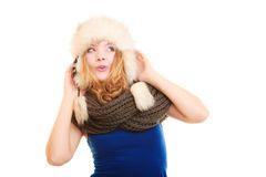 Winter fashion. Happy young woman in fur hat. Royalty Free Stock Image