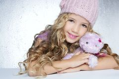 Winter fashion little girl hug teddy bear Stock Photo