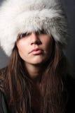 Winter fashion portrait. Fashion woman in fur cap in studio Stock Photos