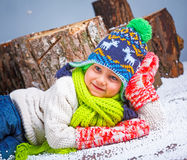 Winter Fashion. Portrait of adorable happy boy. Stock Photos