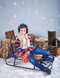 Winter Fashion. Portrait of adorable happy boy. Royalty Free Stock Photo