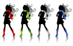 Winter Fashion Silhouettes 3. A clip art illustration of 4 winter fashion female silhouettes wearing colorful scarves and matching boots Royalty Free Stock Images