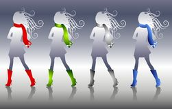 Winter Fashion Silhouettes. A clip art illustrationf of 4 winter fashion silhouettes in silver wearing scarves and matching boots Royalty Free Stock Photos