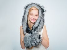 Winter fashion trends for kids. Small fashionista. Happy child smile in fashion style. Small girl wear winter hat scarf. Outerwear. winter holiday and vacation royalty free stock photo
