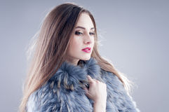 Winter fashion woman in a fur coat. Stock Images