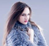 Winter fashion woman in a fur coat. Stock Photos