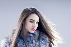 Winter fashion woman in a fur coat. Royalty Free Stock Photo