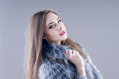 Winter fashion woman in a fur coat. Stock Image