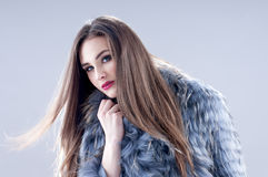 Winter fashion woman in a fur coat. Royalty Free Stock Image