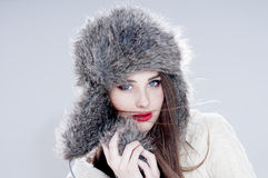 Winter fashion woman in a fur  hat. Stock Photos