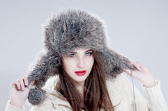 Winter fashion woman in a fur  hat. Stock Image