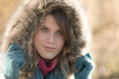 Winter fashion - woman with fur hood Stock Image