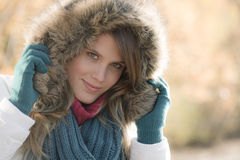 Winter fashion - woman with fur hood Royalty Free Stock Images