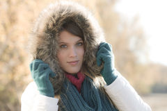 Winter fashion - woman with fur hood outdoors Stock Photo