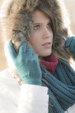 Winter fashion - woman with fur hood outdoors Stock Photos