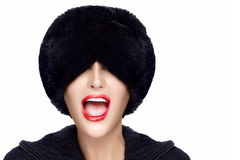 Winter Fashion Young Woman in Fur Hat Gesturing and Grimacing Stock Images