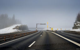 Winter feeling. Winter on the highway in a foggy morning stock image