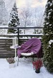 Winter feeling on snowy garden terrace Royalty Free Stock Image