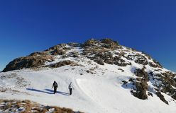 Winter fell walking. Hiking Little Hart Crag in the snow in the Lake District Royalty Free Stock Photography