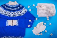 Winter female outfit. Set of clothes and accessories. On blue background Royalty Free Stock Photos